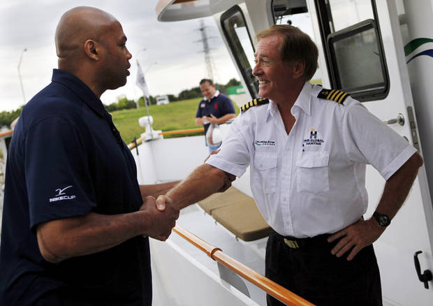 Charles Barkley, left, talks with Capt. Joe Harvey before taking an Oklahoma River Cruise in Oklahoma City, Friday, June 1, 2012. Barkley took the cruise on the Oklahoma River as part of a tour of Oklahoma City. Photo by Nate Billings, The Oklahoman
