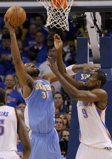 Oklahoma City's Serge Ibaka (9) battles with Denver's Nene (31) under the basket during the first round NBA playoff game between the Oklahoma City Thunder and the Denver Nuggets on Sunday, April 17, 2011, in Oklahoma City, Okla. Photo by Chris Landsberger, The Oklahoman