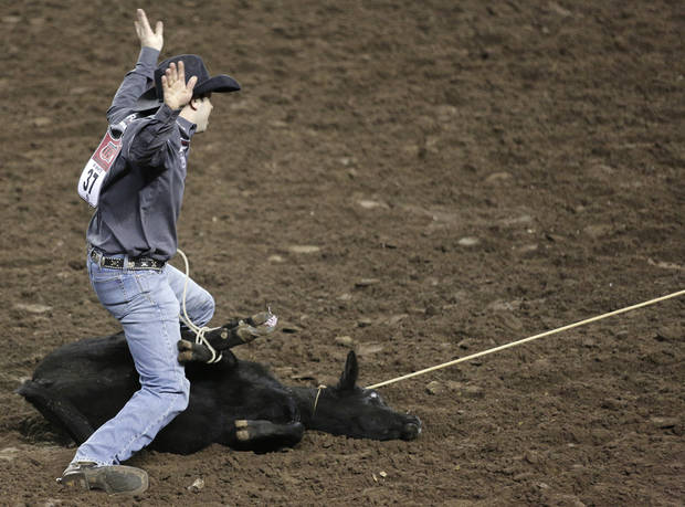Wade White, of Richfield, Wisconsin, competes in Tie-Down Roping during the final performance of International Finals Rodeo at the State Fair Arena in Oklahoma City, Okla., Sunday, Jan. 20, 2013.  Photo by Garett Fisbeck, For The Oklahoman