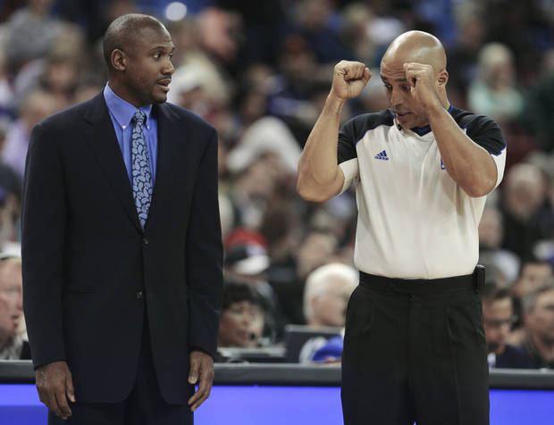 Official Marc Davis, right, explains a call to Phoenix Suns interim head coach Lindsey Hunter, during the first quarter of an NBA basketball game against the Sacramento Kings in Sacramento, Calif., Wednesday, Jan. 23, 2013. Hunter is coaching his first game since replacing Alvin Gentry. (AP Photo/Rich Pedroncelli)