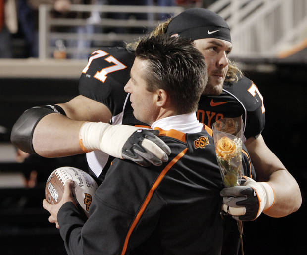 OSU&#039;s Noah Franklin (77) hugs head coach Mike Gundy as Franklin is recognized for senior night at the college football game between Oklahoma State University (OSU) and the University of Colorado (CU) at Boone Pickens Stadium in Stillwater, Okla., Thursday, Nov. 19, 2009. Photo by Nate Billings, The Oklahoman