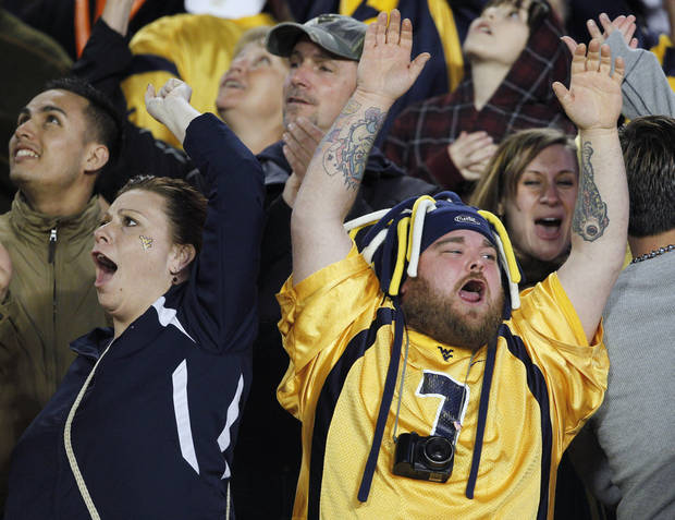 West Virginia fans celebrate a touchdown during the first half of the Mountaineers� Orange Bowl victory over Clemson on Jan. 4. The win capped a strong season and has fans excited for West Virginia�s first season as a member of the Big 12 Conference. AP Photo