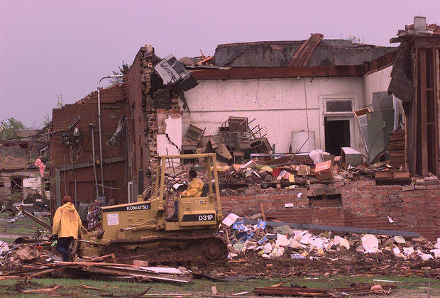 MAY 3, 1999 TORNADO: Tornado damage. Crews start working to clear debris around Mulhall elementary school.