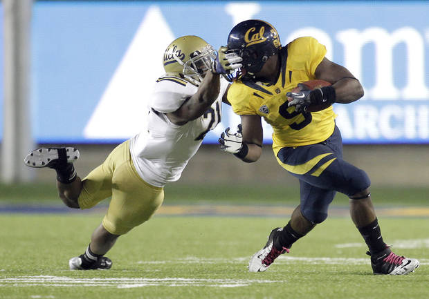 California running back C.J. Anderson (9) is face masked by UCLA cornerback Aaron Hester (21)during the second half of an NCAA college football game in Berkeley, Calif., Saturday, Oct. 6, 2012. California won 43-17. (AP Photo/Tony Avelar)