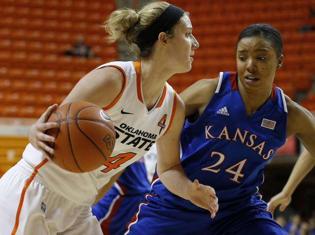 Oklahoma State&#039;s Liz Donohoe (4) dives past Kansas&#039; CeCe Harper (24) during a women&#039;s college basketball game between Oklahoma State University (OSU) and Kansas at Gallagher-Iba Arena in Stillwater, Okla., Tuesday, Jan. 8, 2013. Oklahoma State won 76-59. Photo by Bryan Terry, The Oklahoman