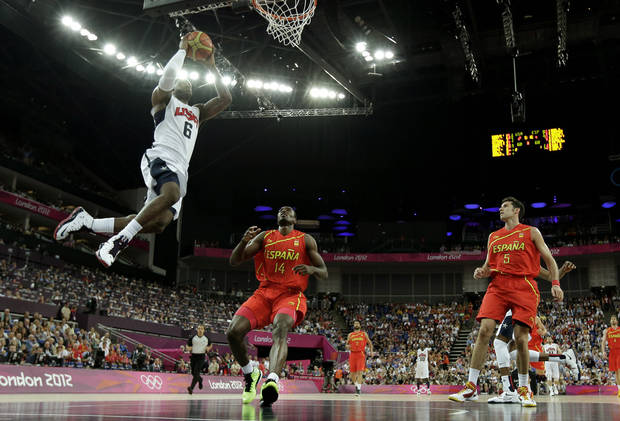 United States' LeBron James goes up for a dunk during a men's gold medal basketball game against Spain at the 2012 Summer Olympics, Sunday, Aug. 12, 2012, in London. (AP Photo/Eric Gay)
