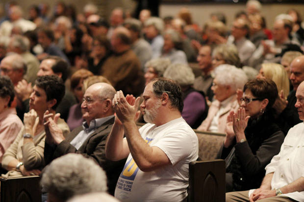 Some members of Presbyterian Church of Edmond applaud Sunday as the vote for the church to leave the Presbyterian Church (USA) was announced during a congregational meeting.  <strong>DOUG HOKE - THE OKLAHOMAN</strong>