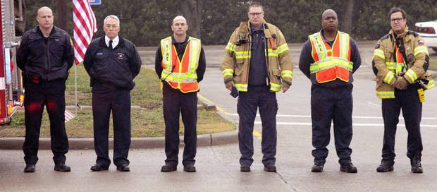 Members of Midlothian Fire Department pay their respects during a procession for Chris Kyle in Midlothian, Texas, Tuesday, Feb. 12, 2013 for the 200-mile journey to Austin, where Kyle will be buried at the Texas State Cemetery. Some 7,000 people attended a two-hour memorial service for Kyle at Cowboys Stadium in Arlington on Monday. Kyle and his friend Chad Littlefield were shot and killed Feb 2. at a North Texas gun range. (AP Photo/Star-Telegram, Max Faulkner)