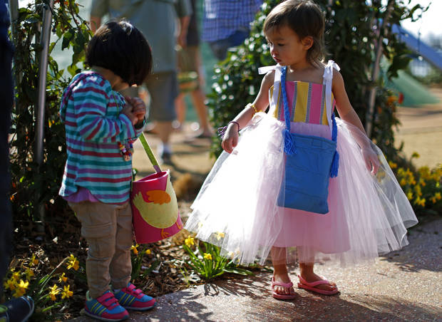 Layla Yeung, 2, of Oklahoma City, at right, looks towards 2-year-old Valentina De La Puerta of Yukon during the Myriad Gardens Annual Easter Egg Hunt in downtown Oklahoma City, Saturday, March 30, 2013. Photo by Bryan Terry, The Oklahoman