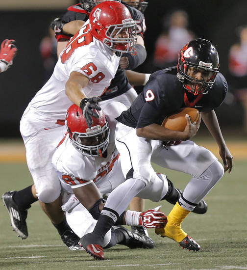 Carl Albert's Robert Lolofie (68) and Chantz Woodberry (80) sack East Central's Trevaughn Cherry (9) during the Class 5A Oklahoma state championship football game between Carl Albert High School and Tulsa East Central High School at Boone Pickens Stadium on Saturday, Dec. 1, 2012, in Stillwater, Okla.   Photo by Chris Landsberger, The Oklahoman
