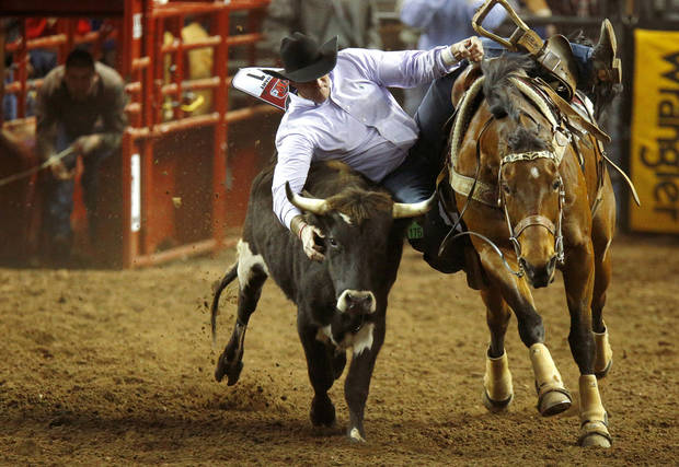 Jason Stewart of Bristow, Okla., competes in steer wrestling during the International Finals Rodeo inside the State Fair Arena in Oklahoma City, Friday, Jan. 18, 2013. Photo by Bryan Terry, The Oklahoman
