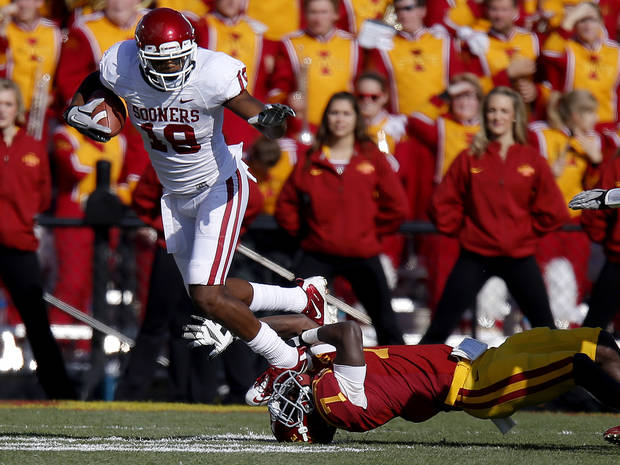 Oklahoma's Justin Brown (19) leaps over Iowa State's Cliff Stokes (7) during a college football game between the University of Oklahoma (OU) and Iowa State University (ISU) at Jack Trice Stadium in Ames, Iowa, Saturday, Nov. 3, 2012. Photo by Bryan Terry, The Oklahoman