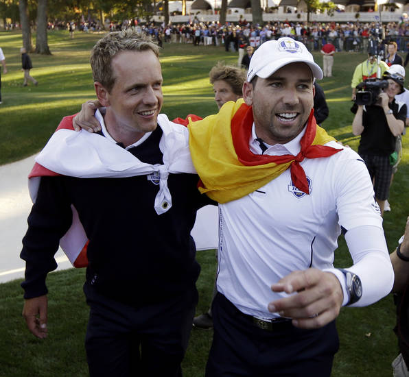 Europe's Sergio Garcia, right, and Luke Donald celebrates after winning the Ryder Cup PGA golf tournament Sunday, Sept. 30, 2012, at the Medinah Country Club in Medinah, Ill. (AP Photo/David J. Phillip)  ORG XMIT: PGA216