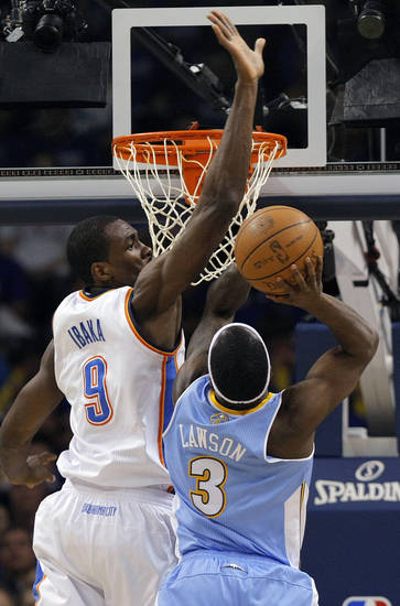 Oklahoma City's Serge Ibaka (9) tries to block a shot by Denver's Ty Lawson (3) during the first round NBA playoff game between the Oklahoma City Thunder and the Denver Nuggets on Sunday, April 17, 2011, in Oklahoma City, Okla. Photo by Chris Landsberger, The Oklahoman
