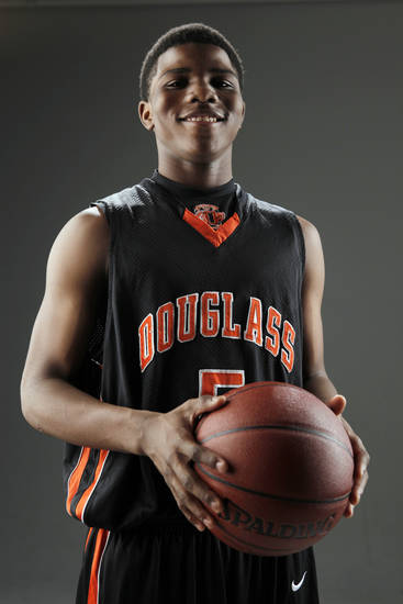 Stephen Clark of Douglass High School, Little All-City boys basketball player of the year, poses for a photo in the OPUBCO studio, Thursday, April 1, 2010. Photo by Nate Billings, The Oklahoman