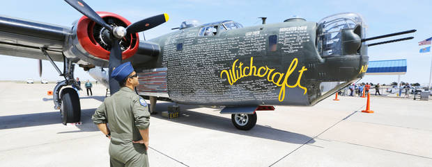 U.S. Air Force Captain Asif Kausar looks at a B-24J Liberator on display Friday at Wiley Post Airport in Bethany. Photos By Steve Gooch, The Oklahoman