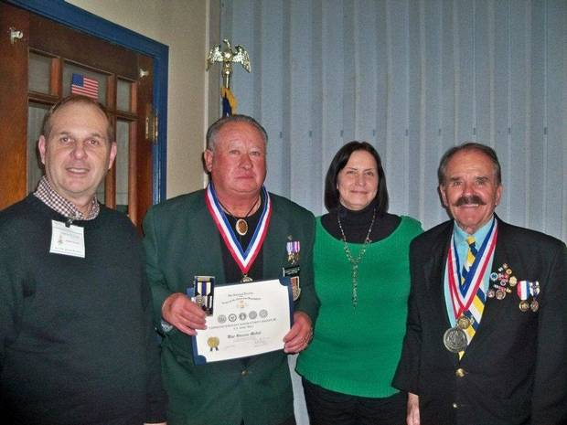 Chapter Vice President Kenneth W. Young, Everett Bagley Jr., Martha Bagley and awards chairman Bill Melton. PHOTO PROVIDED