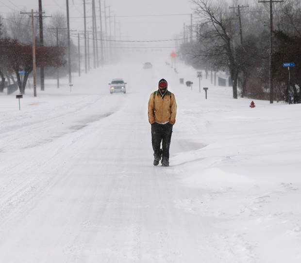 Troy Broyles walks along SE 15th Street in Midwest City as he returns home after taking a walk to a nearby grocery store. A  severe winter storm created whiteout conditions and caused snow drifts that made problems for the few motorists who ventured out Tuesday afternoon, Feb. 1, 2011.   Photo by Jim Beckel, The Oklahoman