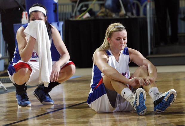 Hammon's Kori Barrios (15), right, and Peyton Walker (23) react after the Class B girls state championship high school basketball game between Hammon and Lomega at State Fair Arena in Oklahoma City, Saturday, March 3, 2012. Lomega won, 49-44. Photo by Nate Billings, The Oklahoman