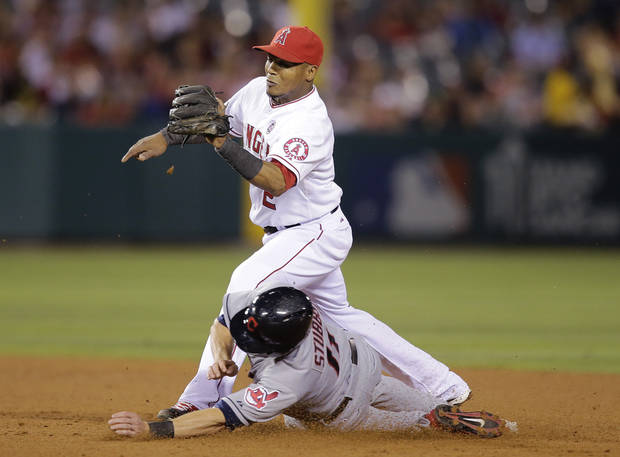Los Angeles Angels' Erick Aybar, top, forces out Cleveland Indians' Drew Stubbs during the eighth inning of an MLB American League baseball game on Tuesday, Aug. 20, 2013, in Anaheim, Calif. (AP Photo/Jae C. Hong)