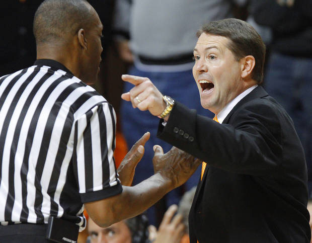 Oklahoma State coach Travis Ford shouts towards official Terry Moore during an NCAA college basketball game between the Oklahoma State University Cowboys (OSU) and the Kansas State University Wildcats (KSU) at Gallagher-Iba Arena in Stillwater, Okla., Saturday, Jan. 21, 2012. Photo by Bryan Terry, The Oklahoman