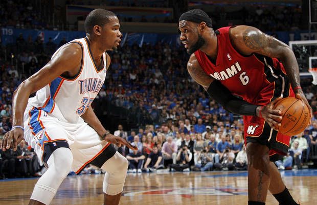 Miami's LeBron James (6) looks to get the ball past Oklahoma City's Kevin Durant (35) during the NBA basketball game between the Miami Heat and the Oklahoma City Thunder at Chesapeake Energy Arena in Oklahoma City, Sunday, March 25, 2012. Photo by Nate Billings, The Oklahoman