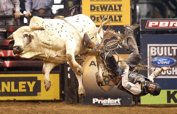 Ty Pozzobon is thrown from Running M's Rambo  during the WinStar World Casino Invitational PBR bull riding event at Chesapeake Energy Arena in Oklahoma City,  Sunday, Jan. 27, 2013.Photo by Sarah Phipps, The Oklahoman