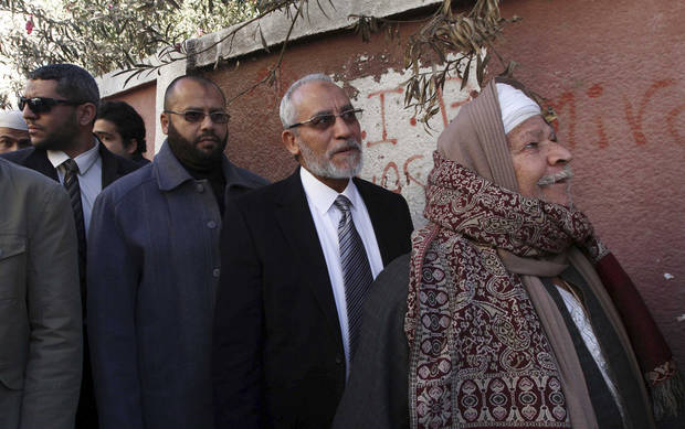 Muslim Brotherhood leader Mohammed Badie, second right, waits in line outside a polling place in Beni Suef, Egypt, to vote on a constitution drafted by Islamist supporters of Presudent Mohammed Morsi, Saturday, Dec. 22, 2012. (AP Photo/Ahmed Ramadan)