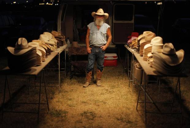 """""""Cactus Jack"""" Owens sells hats for his company, Cactus Hat, during the Woody Guthrie Folk Festival in Okemah, Okla., Thursday, July 12, 2012.  The prices of the hats ranged from $20-35.  Photo by Garett Fisbeck, The Oklahoman"""