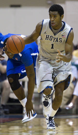 Georgetown forward Hollis Thompson (1) starts the fast break in the  first half of an NCAA college basketball game Wednesday, Nov. 23, 2011, in Lahaina, Hawaii. (AP Photo/Eugene Tanner)