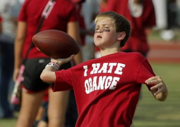 Alex Williams, 12, of Norman throws a football before the college football game between the University of Oklahoma Sooners (OU) and the Tulsa University Hurricanes (TU) at the Gaylord Family-Memorial Stadium on Saturday, Sept. 3, 2011, in Norman, Okla. Photo by Bryan Terry, The Oklahoman ORG XMIT: KOD