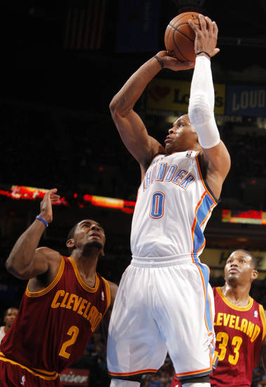 Oklahoma City's Russell Westbrook (0) shoots in between Cleveland's Kyrie Irving and Alonzo Gee (33) during the NBA basketball game between the Oklahoma City Thunder and the Cleveland Cavaliers at the Chesapeake Energy Arena, Sunday, Nov. 11, 2012. Photo by Sarah Phipps, The Oklahoman