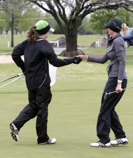 Weatherford's Darby Morgan, left, shakes hands with Poteau's Hannah Ward after Ward's victory in the 4A girl's sudden-death playoff golf match at the Lake Hefner Golf course in Oklahoma City, OK, Thursday, May 2, 2013. Poteau won the top honor on the first hole.  By Paul Hellstern, The Oklahoman