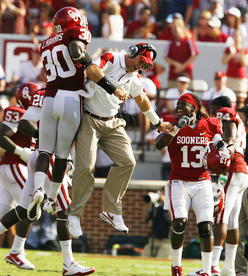 Javon Harris (30) celebrates with a coach after the Sooners recover a fumble during the second half of the college football game where the University of Oklahoma Sooners (OU) defeated the Air Force Falcons 27-24 at Gaylord Family-Oklahoma Memorial Stadium on Saturday, Sept. 18, 2010, in Norman, Okla.   Photo by Steve Sisney, The Oklahoman