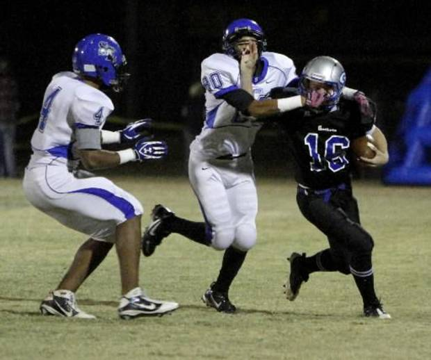 Guthrie quarterback Bryan Dutton runs during his team's 48-0 win over Southeast on Friday. PHOTO BY BRYAN TERRY, THE OKLAHOMAN