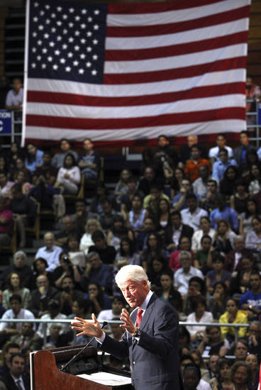 Former President Bill Clinton speaks at Florida International University, Tuesday, Sept. 11, 2012 in Miami, as he campaigns for President Barack Obama. (AP Photo/Wilfredo Lee)