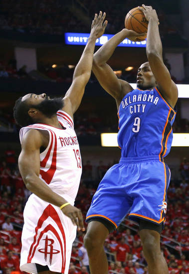 Oklahoma City's Serge Ibaka shoots over Houston's James Harden during Game 6 in the first round of the NBA playoffs between the Oklahoma City Thunder and the Houston Rockets at the Toyota Center in Houston, Texas, Friday, May 3, 2013. Photo by Bryan Terry, The Oklahoman