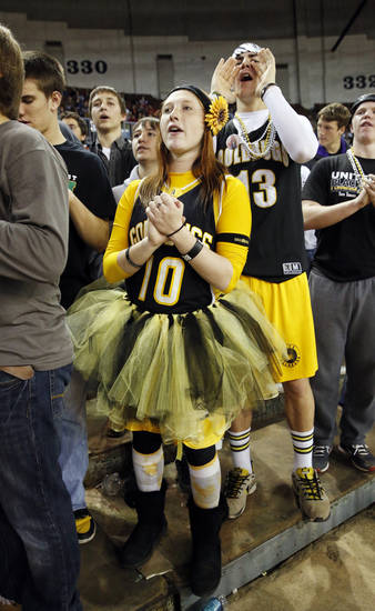 Darian Carothers and Riley Hess cheer during the 2A girls championship game where the Northeast Academy Lady Vikings defeated the Alva high school Lady Bugs 53-36 at the State Fair Arena on Saturday, March 9, 2013 in Oklahoma City, Okla.  Photo by Steve Sisney, The Oklahoman
