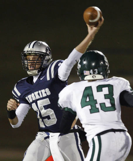 Edmond North's Travis Townsend throws a pass as Edmond Santa Fe's Rane Thomason applies pressure during a high school football game at Wantland Stadium in Edmond, Okla., Friday, Oct. 29, 2010.  Photo by Bryan Terry, The Oklahoman