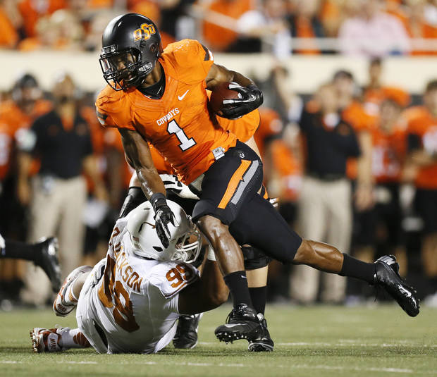 OSU&#039;s Joseph Randle (1) carries the ball past UT&#039;s Desmond Jackson (99) during a college football game between Oklahoma State University (OSU) and the University of Texas (UT) at Boone Pickens Stadium in Stillwater, Okla., Saturday, Sept. 29, 2012. Photo by Nate Billings, The Oklahoman