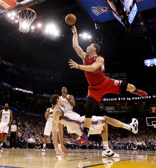 Oklahoma City's Nick Collison (4) draws a charge against Los Angeles' Blake Griffin (32) during the NBA basketball game between the Oklahoma City Thunder and the Los Angeles Clippers at the Oklahoma CIty Arena, Tuesday, Feb. 22, 2011.  Photo by Bryan Terry, The Oklahoman