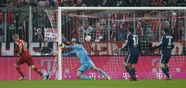 Bayern's Bastian Schweinsteiger scores  during the German first division Bundesliga soccer match between FC Bayern Munich and SV Hamburger  in Munich, southern Germany, on Saturday, March 30, 2013. (AP Photo/Matthias Schrader)