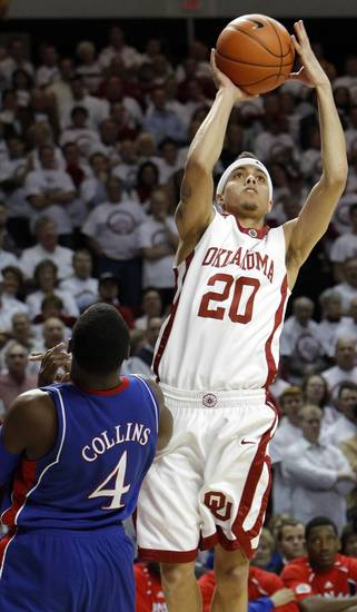 OU's Austin Johnson (20) shoots over Sherron Collins (4) of KU in the first half of the men's college basketball game between Kansas and Oklahoma at the Lloyd Noble Center in Norman, Okla., Monday, February 23, 2009. BY NATE BILLINGS, THE OKLAHOMAN