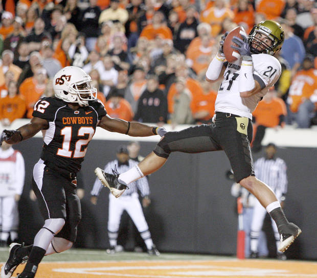 Colorado&#039;s Scotty McKnight catches a touchdown in front of OSU&#039;s Johnny Thomas of OSU during the college football game between Oklahoma State University (OSU) and the University of Colorado (CU) at Boone Pickens Stadium in Stillwater, Okla., Thursday, Nov. 19, 2009. Photo by Bryan Terry, The Oklahoman