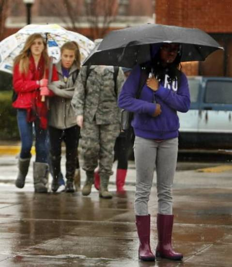 Umbrellas come out as students head to class in the rain on the campus of the University of Oklahoma (OU) on Tuesday, Feb. 12, 2013 in Norman, Okla. Photo by Steve Sisney