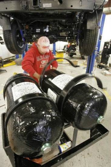 An employer at OEM Systems Inc. in Okarche prepares to install two tanks that will allow a truck to run on compressed natural gas in October 2009. <strong>The Oklahoman archives - David McDaniel</strong>