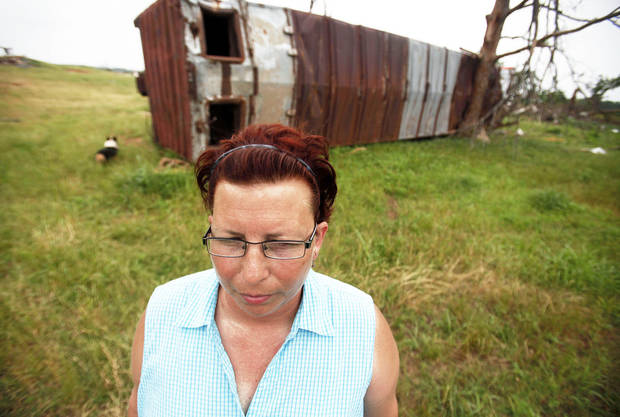 Above: Jackie Dunsworth stands by a boxcar Wednesday on her property near Shawnee. The boxcar was thrown across her 55-acre property during the May 10 tornado outbreak.  Photo by Miranda Grubbs,  The Oklahoman  InsideMore disaster relief centers are open this week.  INSIDE STATE