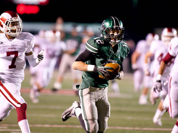 Norman North&#039;s Jake Higginbotham (12) hauls in a touchdown catch during 6A semifinal football between Owasso and Norman North at Union Tuttle Stadium on November 23, 2012.  JOEY JOHNSON/For the Tulsa World ORG XMIT: DTI1211232203119289