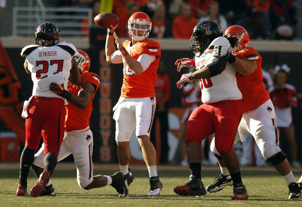 Oklahoma State&#039;s Clint Chelf (10) throws a pass during a college football game between Oklahoma State University and the Texas Tech University (TTU) at Boone Pickens Stadium in Stillwater, Okla., Saturday, Nov. 17, 2012. Photo by Sarah Phipps, The Oklahoman