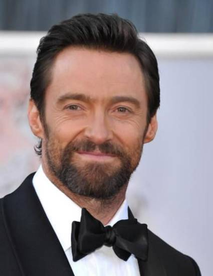 Handsome Hugh Jackman smiles on the Oscars red carpet. (AP)